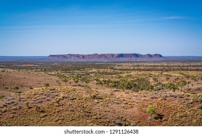 Distant scenic panorama of Gosse's Bluff an eroded remnant of an impact crater in NT central outback Australia