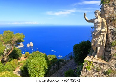 Distant sea and classical statue on Monte Solaro, Capri island, Italy