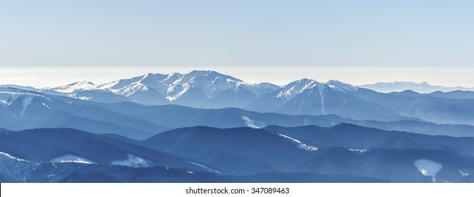 Distant sharp peaks. blue mountain ranges. Ukrainian Carpathian Mountains