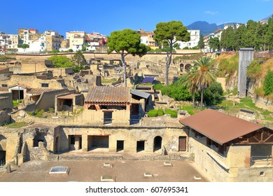 Distant summit of Vesuvius volcano and ancient buildings of Herculaneum, Naples, Italy