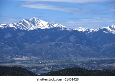 Distant tall snow capped mountain range in Colorado near Salida.