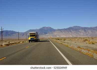 Distant truck is only traffic  on desert highway in Nevada