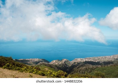 distant view to Calheta Village and Atlantic Ocean from Madeira mountains