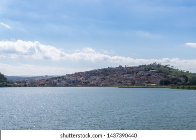 Distant view of the Capitolio village as seen from the other side of Lagoa de Capitolio lagoon, at Rua Sao Sebastiao street in Capitolio, Minas Gerais - Brazil.