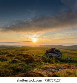 Distant view of Hound Tor at sunrise, Dartmoor, UK