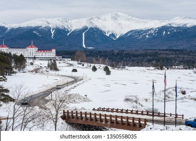 A distant view of Mount Washington, New Hampshire during winter, with the Omni Mount Washington Resort in the foreground.