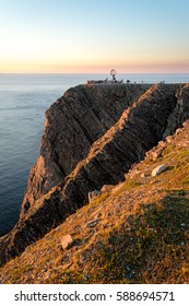 Distant view of North Cape (Norwegian: Nordkapp) with cliffs during sunset. Northern coast of the island of Magerøya in Northern Norway. (Nordkapp Municipality in Finnmark county, Norway)