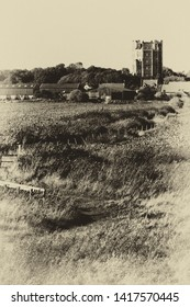 Distant view of Orford Castle across fields from the footpath along the Ore Estuary, Suffolk, UK. Grainy antique vintage sepia effect.