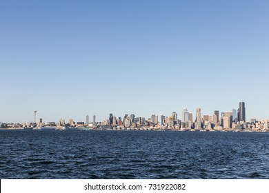 A distant view of Seattle skyline, with many office towers and skyscrapers and the Space Needle on the left, in Washington state largest city in the USA