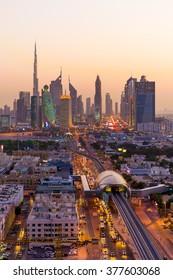 Distant view of skycrapers in orange sunset in Dubai, United Arab Emirates