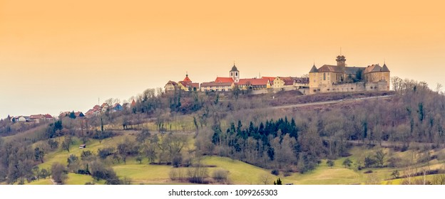 distant view of Waldenburg, a town in Hohenlohe in Southern Germany at evening time