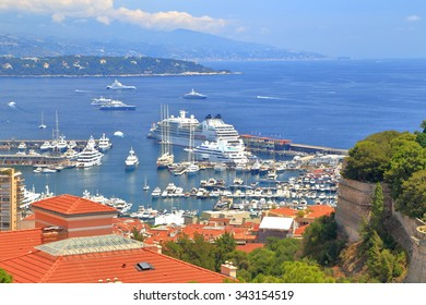 Distant yachts and cruise ship in the harbor of Monte Carlo, Monaco, French Riviera