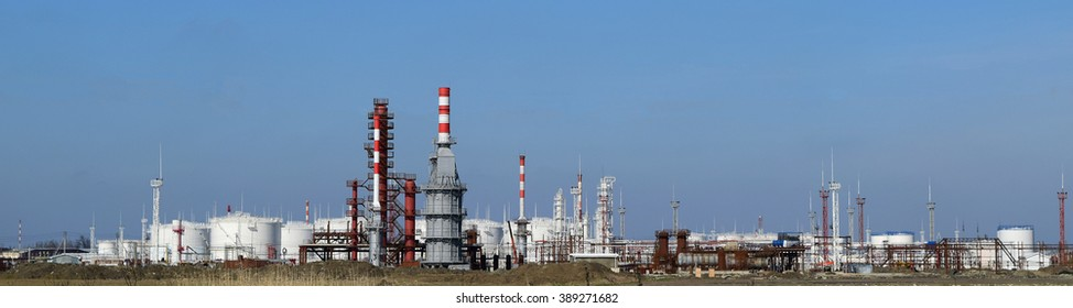 Distillation columns, pipes and other equipment furnaces refinery. The oil refinery. Equipment for primary oil refining.