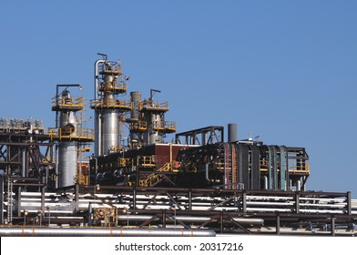 Distillation towers and oil and gas pipelines at a petrochemical plant