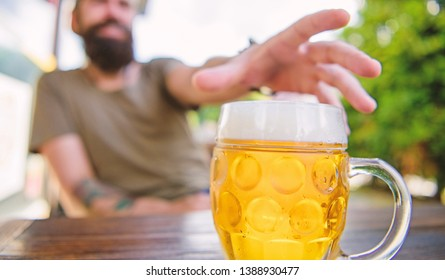 Distinct beer culture. Mug cold fresh beer on table close up. Man sit cafe terrace enjoying beer defocused. Alcohol and bar concept. Creative young brewer. Craft beer is young, urban and fashionable.