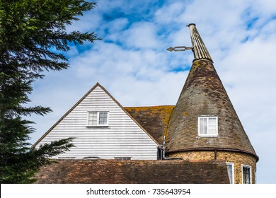 The distinctive roof shape of an oast house conversion in kent, UK