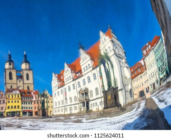 Distorted Abstract Martin Luther Statue Colorful Market Square Rathaus City Church Lutherstadt Wittenberg Germany. Statue from 1800s.