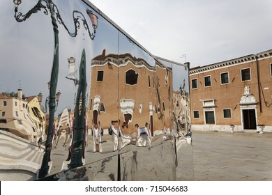distorted mirroring of buildings in venice/italy