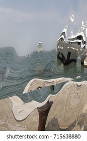 distorted mirroring of ship and sea in venice/italy