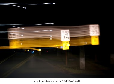 Distorted night view of street lamps and traffic signs from drunk, drugged, sleepy, or medicated drivers.