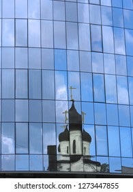 Distorted reflection of the domes of the Russian old believers orthodox church of the Sign of Our Lady in the windowed wall, Saint-Petersburg, Russia