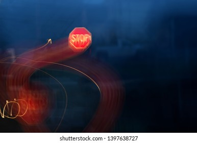 Distorted stop sign at road intersection as seen from drunk, drugged, or sleepy drivers.