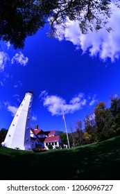 A distorted view of the North Point Lighthouse in Milwaukee Wisconsin taken with a fisheye lens for special effects.