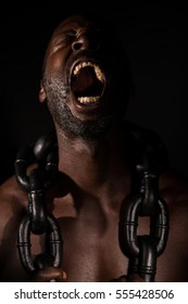 Distraught Black Slave With Large Chain
