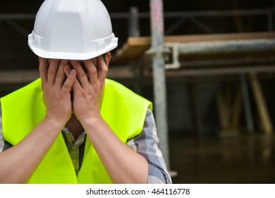 Distraught Construction Worker the hands on his face