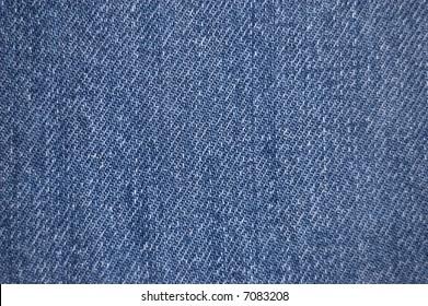 Distressed blue denim fabric texture