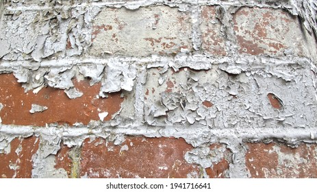 Distressed and damaged textures on buildings in a rundown urban area.