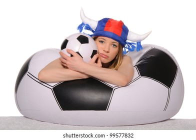 Distressed football cheerleader with  ball on couch