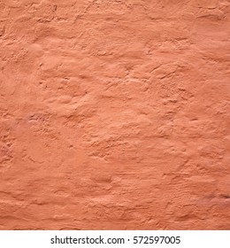 Distressed Red Plaster Wall With Cracked Surface Frame Grunge Background. Brown Brick Mortar Wall With Broken Shabby Stucco Layer Isolated Square Texture.  Empty Grunge Built Exterior House Structure