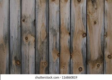 Distressed untreated wooden plank door.