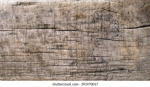 Distressed wooden board texture photo. Close-up of dirty cracked plank