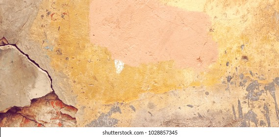 Distressed Yellow Brown Old Brick Wall With Graffiti Art Wide Background And Texture. Damaged Concrete Wall With Painted Lines And Draw. Abstract Web Banner