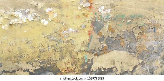 Distressed Yellow Brown Old Brick Wall With Graffiti Street Art. Rough Background And Wide Texture. Shabby Concrete Wall With Painted Surface. Abstract Grunge Grafitty Wallpaper. Abstract WEB Banner