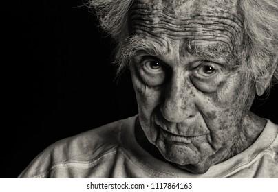 Distressing Image of senior man on Black