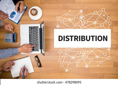 DISTRIBUTION  Business team hands at work with financial reports and a laptop