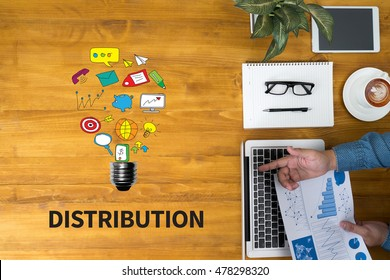 DISTRIBUTION  Businessman working at office desk and using computer and objects, coffee, top view, with copy space