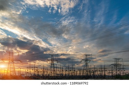distribution electric substation with power lines, at sunset.