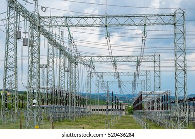 Distribution electric substation with power lines and transformers.