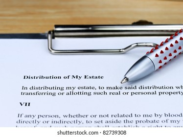 A distribution of my estate form ready for you to complete, showing the will, ball point pen on a metal clipboard.