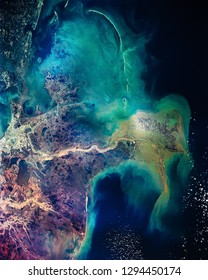 Distribution pattern of muddy fresh water from the Mississippi River as it flows into the Gulf of Mexico. New Orleans. Colorful collage. The elements of this image furnished by NASA.