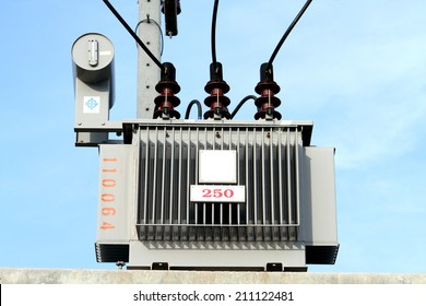 Distribution transformer on concrete pole