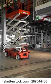 distribution warehouse hall with hydraulic scissors lift platform