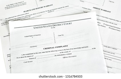District Court criminal complaint, arrest warrant and search and seizure warrant doccuments isolated on white