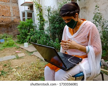 District Katni, madhya pradesh, India - May 16, 2020: An asian office girl doing video conferencing during work from home.