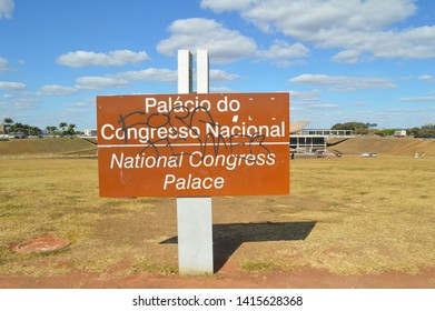 """Brasília/Federal District/Brazil - July 21 2018: Photography of the road sign of the Nacional Congress Palace of Brazil graffited """"Fora Temer"""" (means """"out Temer"""") against the Michel Temer government"""