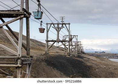 Disused coal conveyor, Longyearbyen, Spitsbergen, Svalbard Archipelago, Norway. Adventfjorden and Spitsbergen airport visible in the distance.
